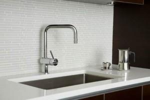 white glas tiles backsplash contrast dark cabinetry provides the clean line