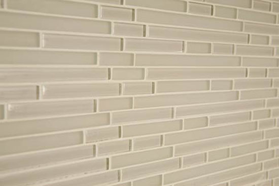 white glas tiles backsplash contrast dark cabinetry provides the clean lines
