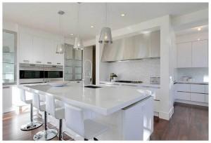 white kitchen design ideas glamorous white kitchen designs images with black wood kitchen floors and grey backsplash with white cabinets also pendant lights breakfast bar white kitchen designs