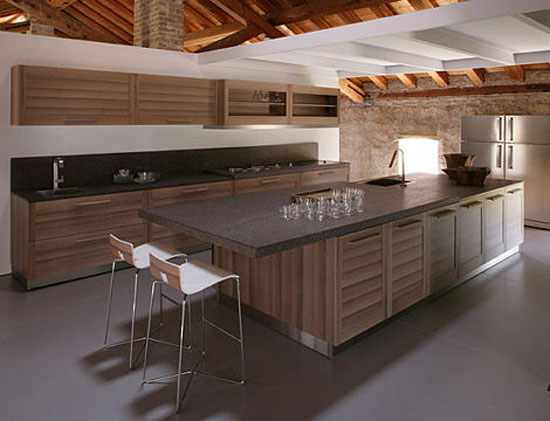 Contemporary Fiamma kitchens use smooth cabinet fronts banded with stripes dark grain