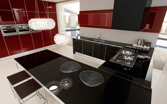 Contrasting red and black color Ultra modern kitchen design by Futura Cucine