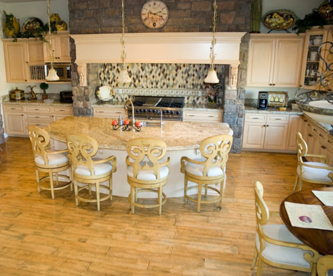 The rounded design on the dining side kitchen island