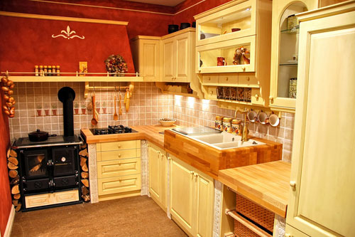 The striking red used as a major accent color of style French country kitchen