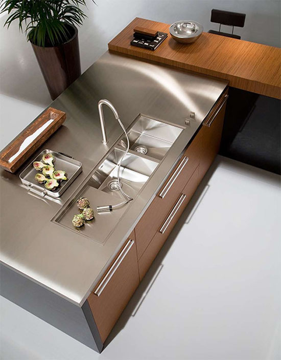 Urban Kitchens Designs stainless steel double sink connected to the worktop from Copat