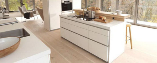 great white kitchen design reducing six large drawers for storage by Bulthaup
