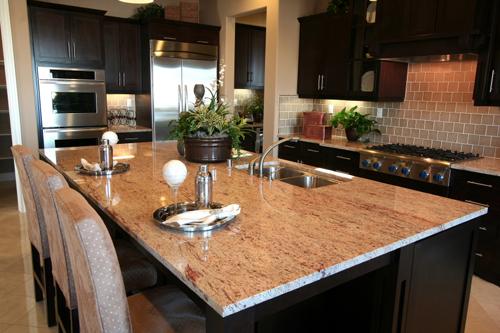 the functional sleek granite on kitchen island