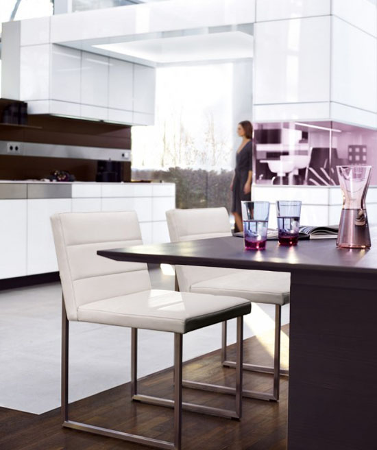white kitchens cabinets and wooden walls has modern minimalist kitchen style